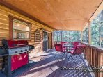 Covered deck with propane grill and wooded view