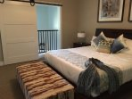 Spacious Master Bedroom in Loft with King Bed and Sliding Barn Door for Privacy