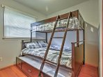 This handsome bunk bed features a pullout trundle for additional sleeping options.