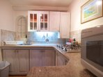 Kitchen equipped and furnished with granite tops.