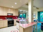 Fully Equipped Spacious Kitchen with Convenient Dining Area