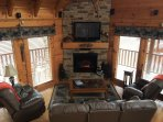Leather furniture with 4 recliners. Hand carved mantle on stack stone fireplace