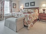 You'll feel right at home in the spacious master bedroom.