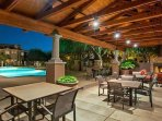 Community pool with large covered patio and outdoor fire-pit