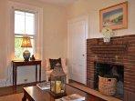 Living room with original fireplace.