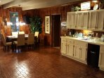 Fully stocked wet bar and dining room area