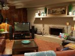 Family room with 50 inch big screen TV and fireplace