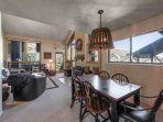Open and spacious living room with leather furnishings, vaulted ceilings, HDTV, entertainment center, fireplace and...