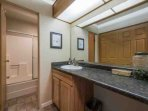 The en suite bathroom (3) is equipped with an extra long vanity, bathtub and shower.