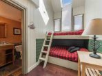 The bunk room (4) features a bunk bed with full size bed on the bottom and twin size bed on the top bunk and a full en...