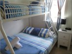 Fourth bedroom with a tri-bunk
