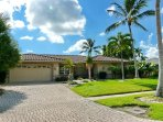 Waterfront home w/ two master suites & large, heated pool