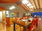 Open plan kitchen, dining area and lounge to patio