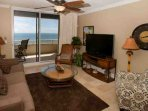 Living room with TV/Blu-Ray player and access to a tiled Gulf-front patio