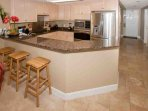 Kitchen with granite countertops, seating for 3