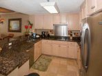 Kitchen with cooktop, stainless steel appliances and ceramic tile floors