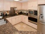 Kitchen with coffee pot, electric can opener, blender, built-in microwave and oven