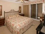 Master bedroom with King bed, night tables, landline phone and side chair