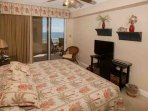Master bedroom with King bed, TV/DVD player, private access to Gulf-front patio