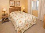2nd bedroom with queen bed, rattan bedroom furniture suite