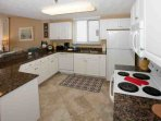 Kitchen w/ceramic tile floors, refrigerator/freezer, stove/oven, dishwasher and built-in microwave