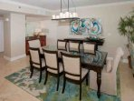 Formal dining area with table for 8 and wet bar