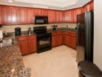 Kitchen with granite counters and full appliances