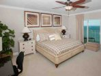 Master bedroom with king bed, desk and sliding glass doors to Gulf-front patio