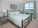 Guest bedroom with king bed and lagoon view