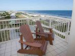 Tiled patio with Adirondack chairs overlooking Gulf