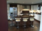 Kitchen Area with Rangemaster cooker, American style fridge freezer, dishwasher, granite worktops