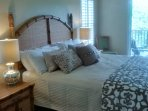 First master bedroom with king size bed,  hotel mattress, private patio, walk in closet and TV.