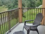 Relax on the private second floor patio overlooking undeveloped forest.