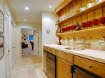 The Wet Bar/Utility Room Leads to the Family Room