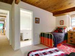 The Cowboys and Indians Bedroom Features Two Brass Twin Beds and A Full Bath