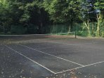 The tennis court at Daisy Lodge. We provide raquets and tennis balls for our guests.