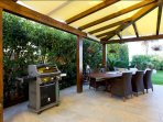 barbecue and outdoor dining table
