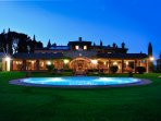 Fan shaped pool set in large lawns with magnificent views.