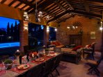 The pool side logia with dinning area, pizza oven and relaxing area.