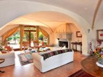 The sitting room with open fire place and exit to the terrace and Lemonia.