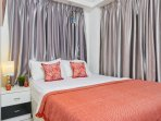 King size bed with hotel linens