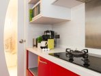 Fully-equipped kitchen with electric stove