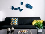 Complimentary colors in this black sofa.