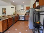 Full size gourmet kitchen with large oven/stove, dishwasher, microwave & cookbooks to inspire you.