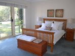 Master bedroom has Queen bed and en-suite overlooking dam with views to stunning escarpment.