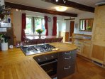 Seating for 12-14 in the Cottage Breakfast Kitchen, complete with wood burning stove