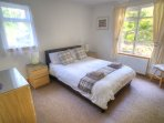 Downstairs double bedroom with leather bed and built in wardrobe Two windows overlooking the garden