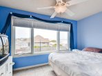 You'll sleep soundly in this bright and airy bedroom.