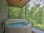 Soak up some much needed relaxation in the private hot tub.