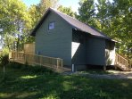 View of the handicap ramp on the cottage's North side. The cottage is fully accessible.